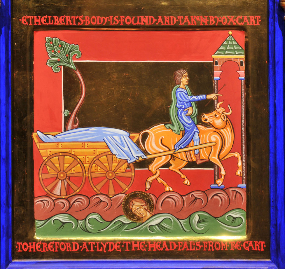 An icon style painting in rich jewel colours with gold embellishment: an ox draws a cart behind him and looks backward as a head falls to the ground