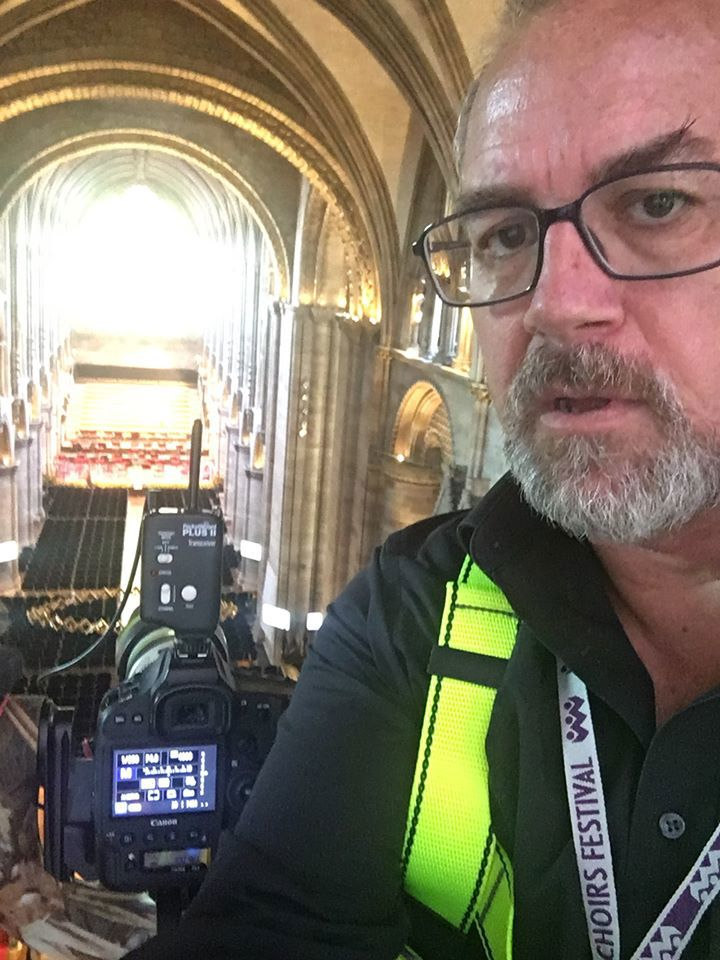 A selfie of Michael taken from high up in the cathedral, his camera is set up ready to take pictures of the Three Choirs Festival