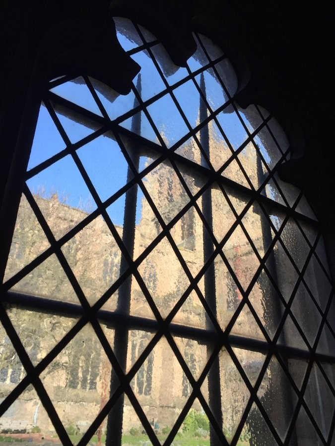 A view of the cathedral tower through the medieval glass window