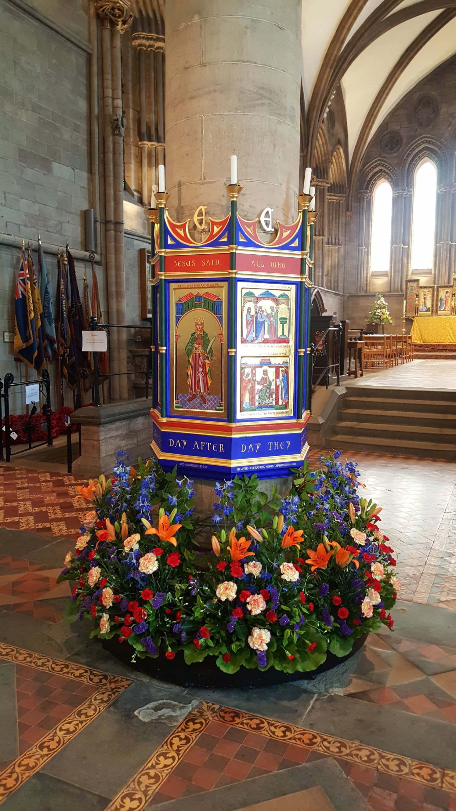 The shrine at the entrance to the Lady Chapel, there are huge floral displays at the base of the shrine picking out key colours - blue, red and gold