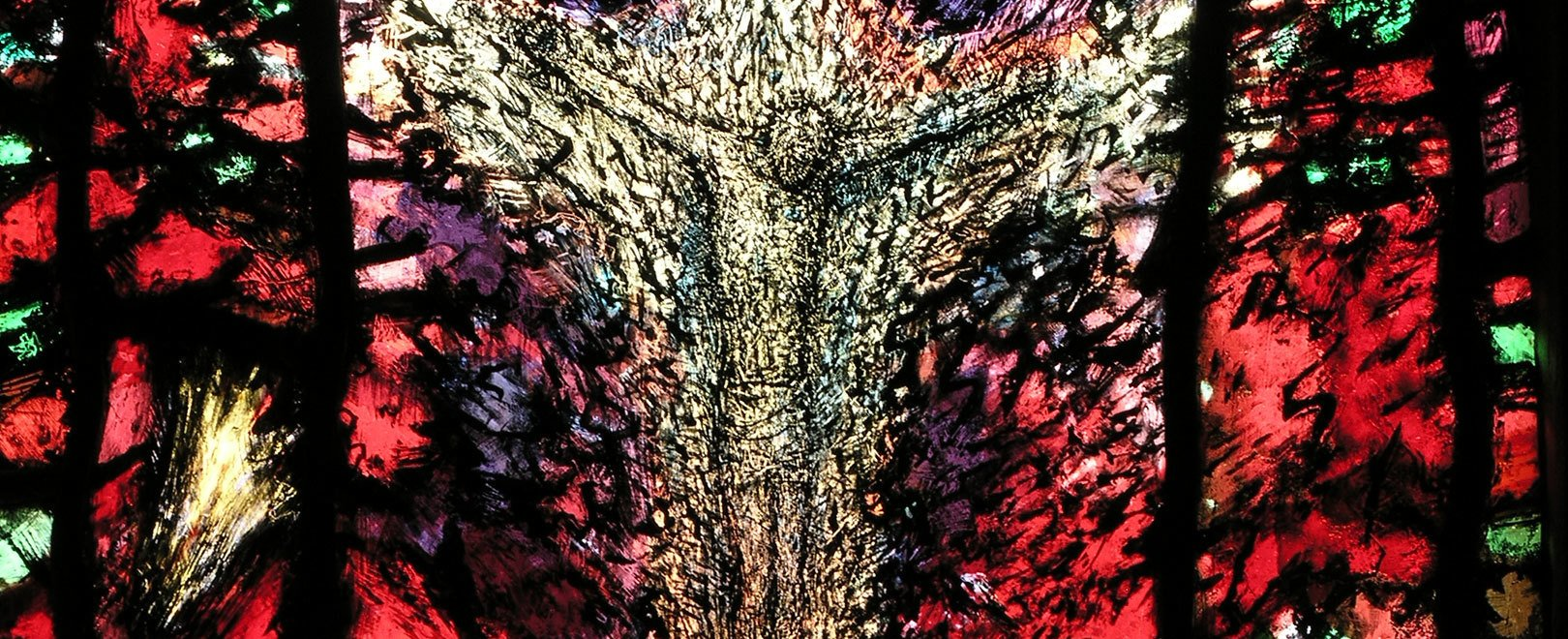 A detail from one of the windows by Tom Denny